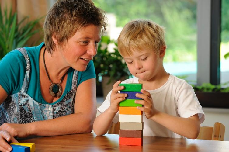 Woman with boy playing with bricks