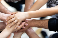 Image of group of people holding hands
