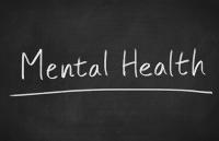 Image of blackboard with 'Mental Health' written on it.
