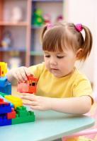 Picture of little girl playing with toys