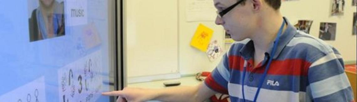 young man using assistive technology