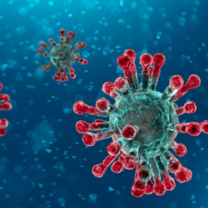 Image of coronavirus coloured red and green, on a blue background
