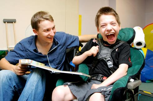 Young disabled boy and young man
