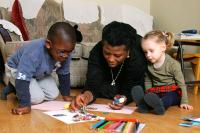 Childminder doing craft activity with young children