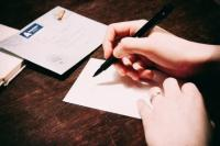 Person writing letter