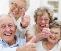 Image of older people with thumbs raised