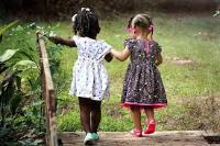 Two little girls walking in nature