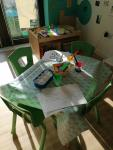 Children's table with activities laid out on it