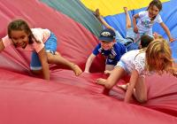 Children on a bouncy assault course