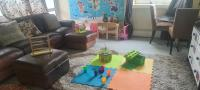 Living room with toys laid out on floor