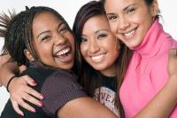 Three women hugging, smiling