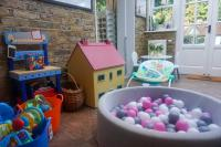 Indoor playroom showing dolls house and ball pit