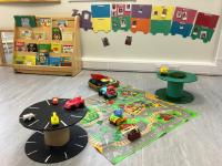 Play space on floor with road rug and small table