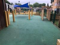 Outdoor play area with climbing frame
