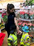 Childminder in food shop with two children