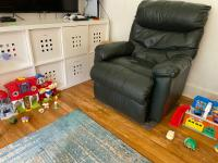 Living room with black arm chair and toys