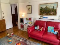 Living room with red sofa and toys on the floor
