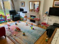 Living room with lots of toys out