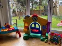 Open play area looking out through patio doors onto the garden