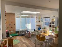 A room set up with little tables and chairs and activities