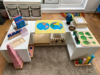 An activity station with lots of different toys on it
