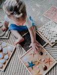 Child playing with sensory path on the floor