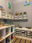 Room with shelves and drawers with toys and activities