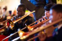 Row of young people playing trombones