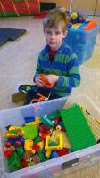 Young boy playing Lego at one of our drop in sessions