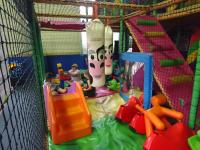 A group of children playing inside the play area at our SEN relaxed soft play session.