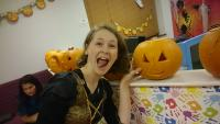 Previous year's party of a child proud of their pumpkin carving