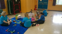 Young children playing at a family drop in session