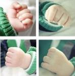 Four photos of individual baby hands