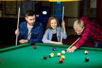 Young people playing snooker