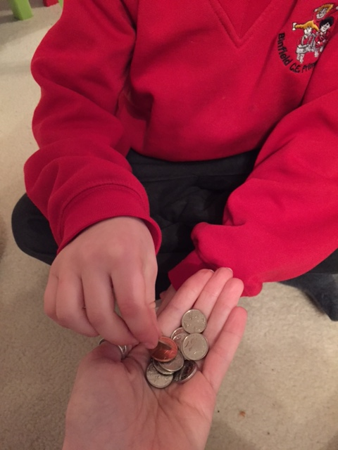 Child counting money on a family learning course