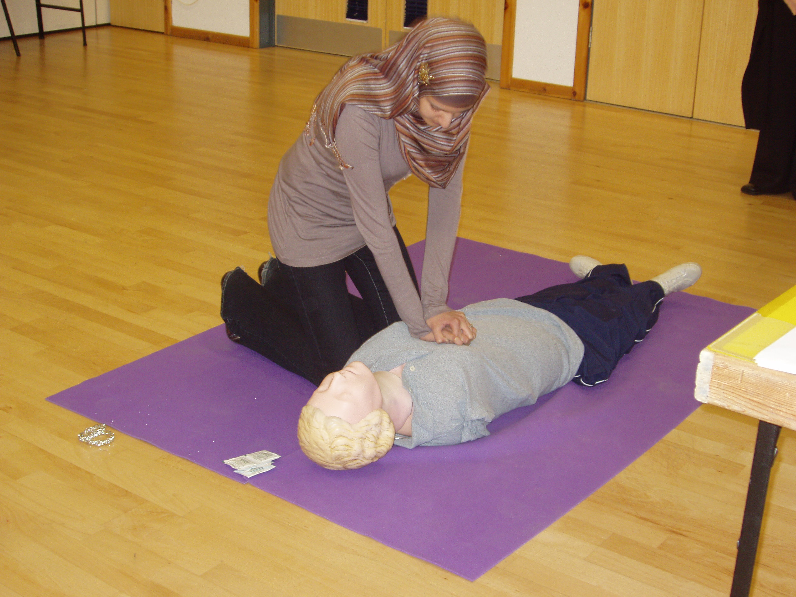 Photo of a first aid training session, person being resuscitated