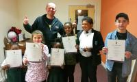 Gary from RAW presenting young people with Arts Award Discover certificates.