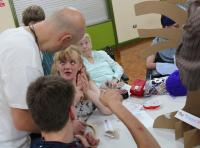 Alex from RAW working with adults at Albert Day Centre