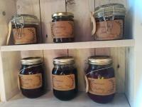 Home made jams made with fruit from the allotments displayed on beautiful shelves made by our carpentry group.