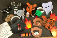 Masks created by young people from 'Let Us Play' for a 'Jungle Book - Story of Mowgli' performance featuring music, performance and artwork.